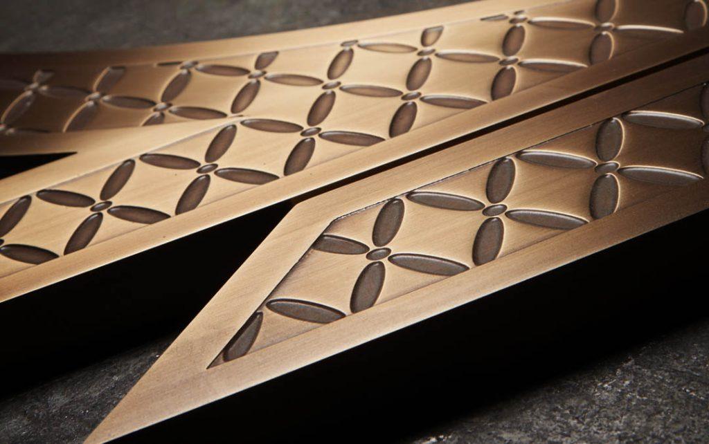 Fabricated bronze door pulls