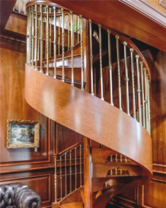 Wood Spiral Stairway with Custom Bronze Spindles